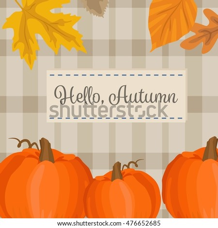 Autumn season background with pumpkin, yellow leaves and plaid fabric. Hello autumn