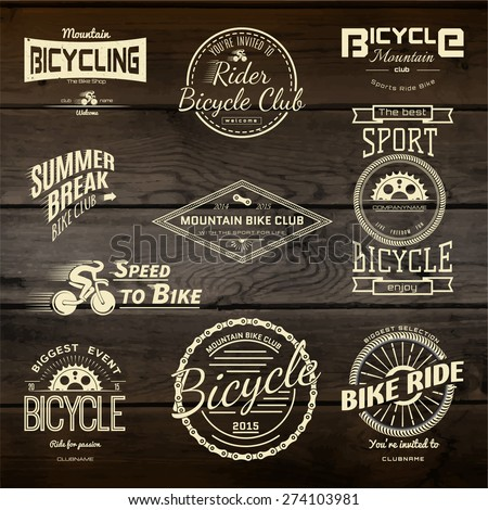 Bicycle set badges logos and labels for any use, on wooden background texture. EPS10 - stock vector