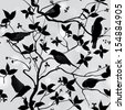 Birds silhouette on branch and  leaf seamless background. Floral vector pattern. Vector ornamental illustration.  - stock