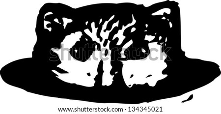 Black and white vector illustration of a gopher in a hole