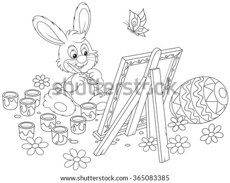 Black and white vector illustration of a happy little bunny drawing a decorated Easter egg on his canvas