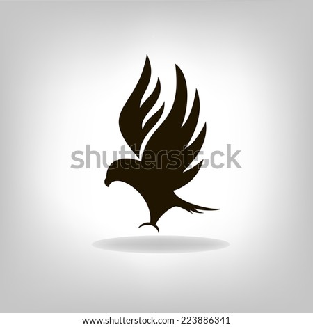 Black bird isolated with expanded wings - stock vector
