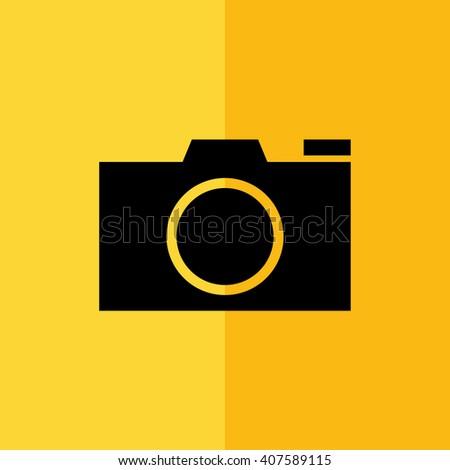 Black camera vector icon. Yellow background - stock vector