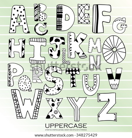 Black chalk pencil alphabet uppercase letters.Hand drawn written with stripe and polka dot style