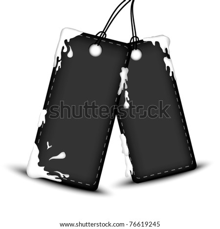 Black price tags with drops of white color