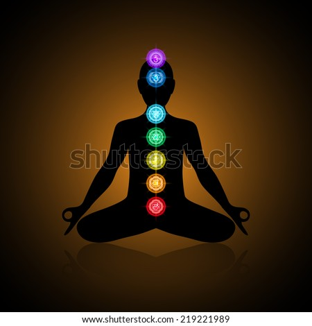 Black silhouette of a human in lotus position with colorful chakras - stock vector