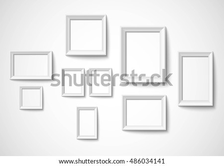 Blank art frame set isolated on wall