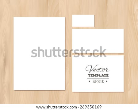 Blank corporate identity templates on a wooden background. Stationery templates. Paper sheet, business card, letterhead. EPS 10 vector.  - stock vector