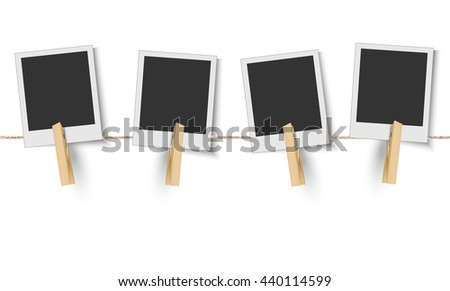 Blank photo frames hanging on the clothesline