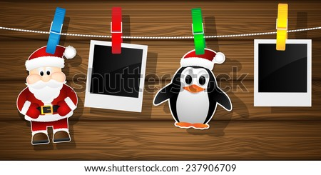 Blank photo frames, penguin and Santa Claus on a clothesline. Vector illustration.  - stock vector