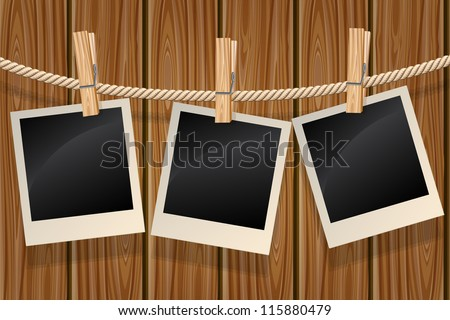 Blank photos hanging on a clothesline against a wooden wall - stock vector