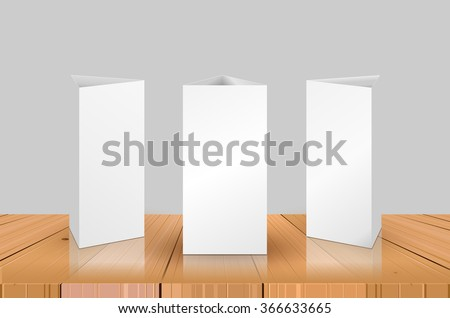 Blank Table Tent isolated on wooden table background. Paper vertical triangle cards on white background & Blank Table Tent Isolated On Wooden Stock Vector 366633665 ...