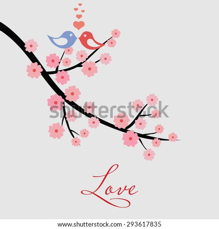 Blooming cherry tree branch with love birds