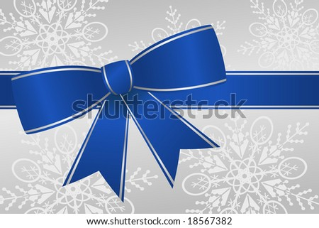Blue and silver ribbon bow on snowflake background for Hanukkah, Christmas or winter holidays.