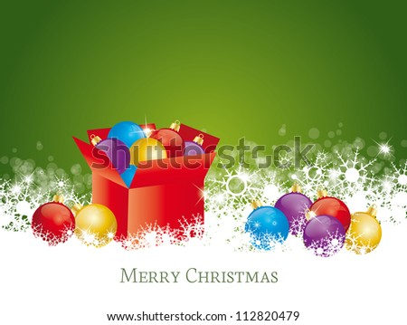 box full of Christmas decorations on green background