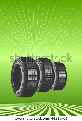 Brand new tires on a green background - stock vector