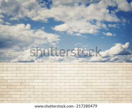 Brick wall with clouds and sky background