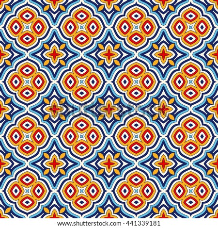 Bright ethnic abstract background. Seamless pattern with symmetric geometric ornament. Ornamental vivid wallpaper. Vector illustration - stock vector