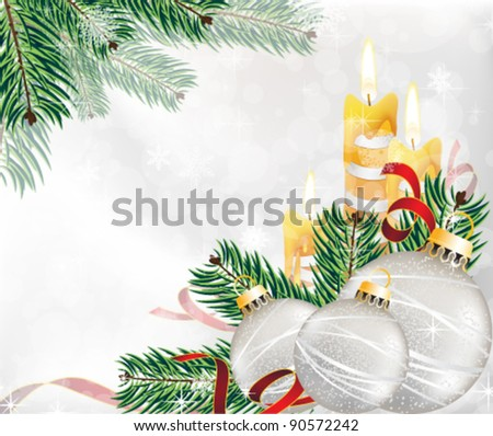 Burning candles, spruce twig, tinsel and Christmas decorations on a sparkling background
