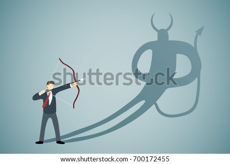 Businessman Aiming bow with arrow to his own Devil shadow