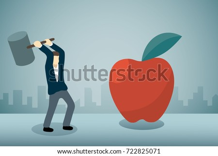 Businessman breaking big apple with hammer.