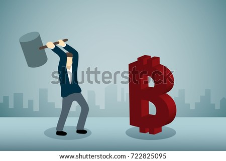 Businessman breaking Bitcoin Sign with hammer
