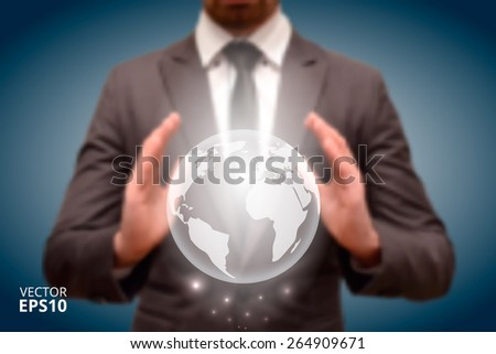 Businessman holding Earth planet in hand.