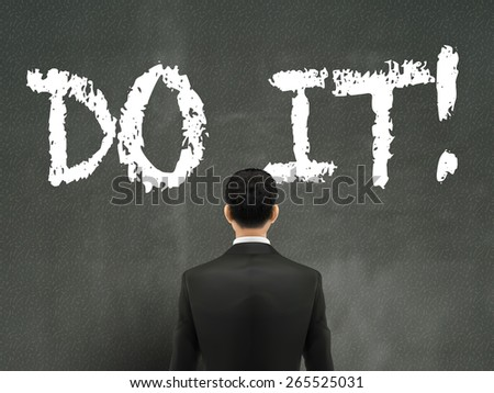 businessman looking at do it words on wall - stock vector