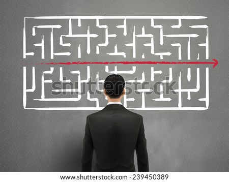 businessman looking at hand drawn maze over grey  - stock vector