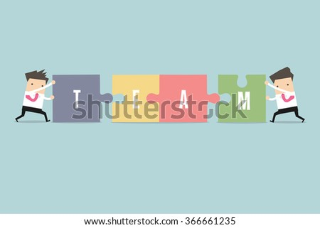 Businessman pushing jigsaw pieces with the word team - stock vector
