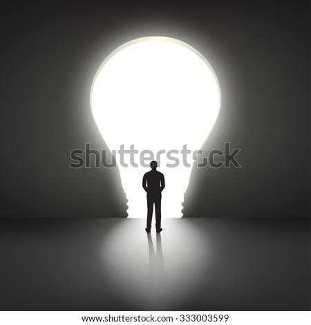 Businessman silhouette standing front of big idea light bulb door. Vector Illustration - stock vector