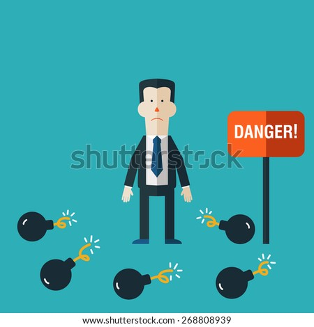 Businessman standings between bombs. Businessman in risk concept