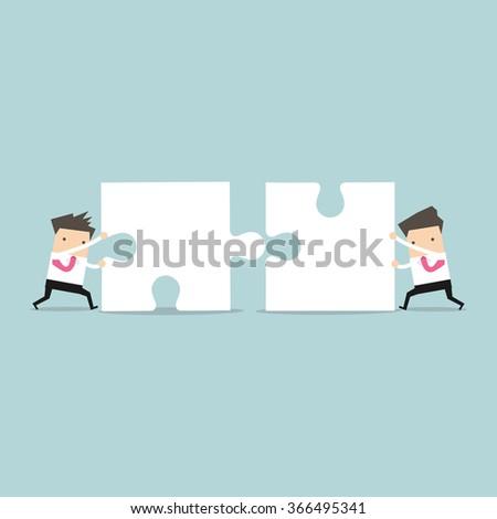 Businessman teamwork pushing jigsaw together - stock vector