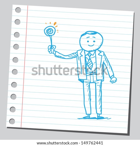 Businessman with lollipop