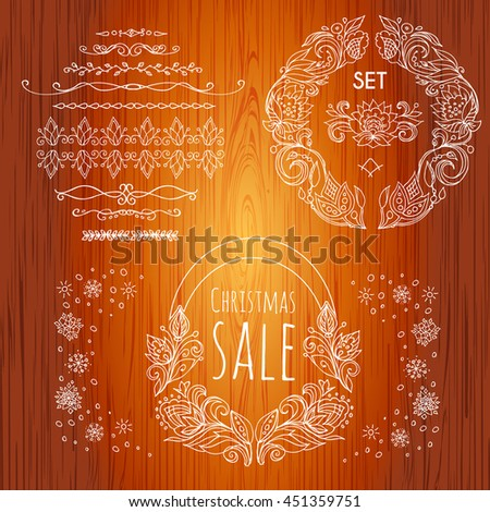 Calligraphic element border. Set  pattern frame of the branches of the flovers  and snowflakes. Wooden background. Hand drawn Floral ornament of leaves and flowers.Vintage style.Vector. - stock vector