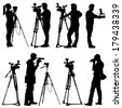 Cameraman with video camera. Silhouettes on white background. Vector illustration. - stock