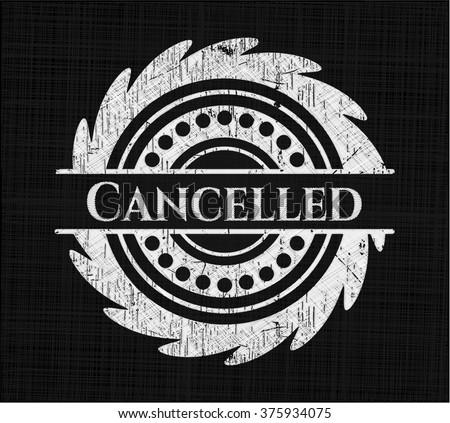 Cancelled chalkboard emblem written on a blackboard - stock vector
