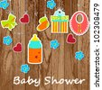 Card with a baby elements on wooden background. Vector illustration. - stock photo