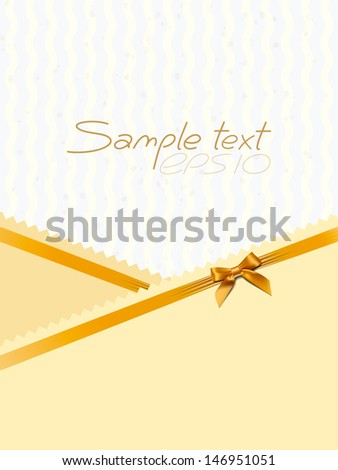 card with a gold bow