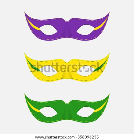 Carnival masks in different colors on a white background. - stock vector