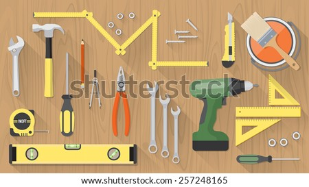 Carpentry and home renovation tools on a wooden table top view - stock vector