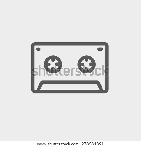 Cassette tape icon thin line for web and mobile, modern minimalistic flat design. Vector dark grey icon on light grey background. - stock vector