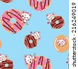 Cats on a donut seamless pattern - stock vector
