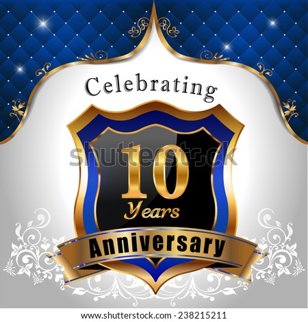 celebrating 10 years anniversary, Golden sheild with blue royal emblem background - vector eps10