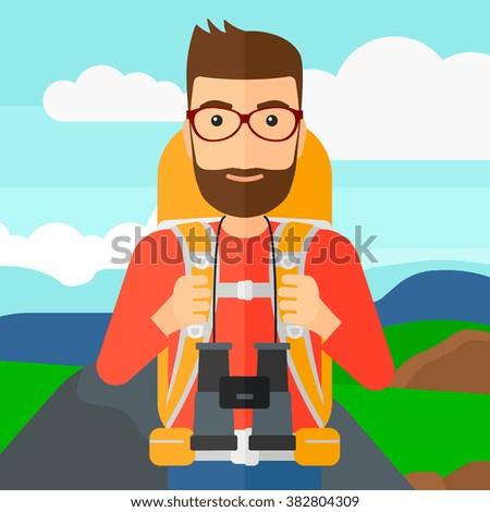 Cheerful backpacker with binoculars. - stock vector