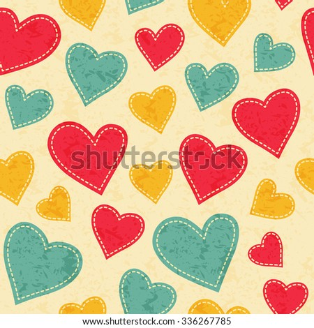 Childish seamless pattern with red, yellow and blue hearts. Hand-sewn style elements with white seams. Bright and happy color palette. - stock vector