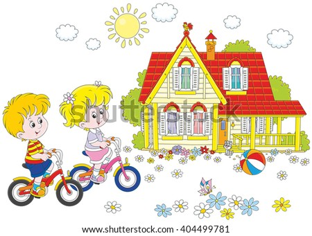 Children riding bicycles on a sunny summer day near a country house