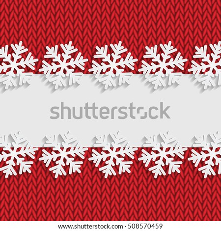 Christmas and New Year's background with place for your text.White snowflakes on a red knitted background