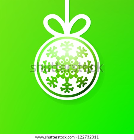 Christmas ball cutted from paper on green background. + EPS8 vector file