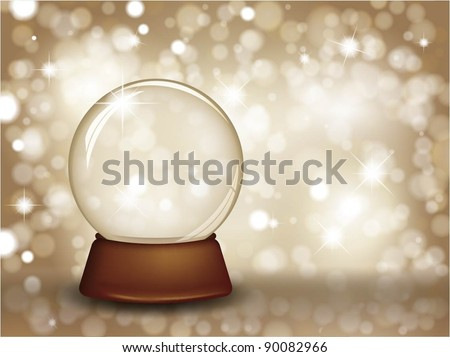 Christmas snow globe on a golden bokeh lights background